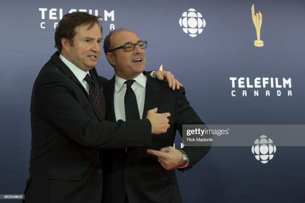 Comedian Steve Patterson gives Academy Chair Martin Katz a hug on the red carpet. Canadian Screen Awards red carpet at Sony Centre for the Performing Arts ahead of the show.
