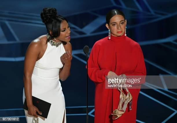 Comedian Tiffany Haddish and US actress Maya Rudolph present the Oscar for Best Documentary Short Subject during the 90th Annual Academy Awards show...