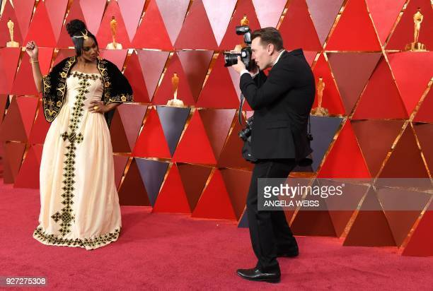 Comedian Tiffany Haddish is photographed as she arrives for the 90th Annual Academy Awards on March 4 in Hollywood California / AFP PHOTO / ANGELA...