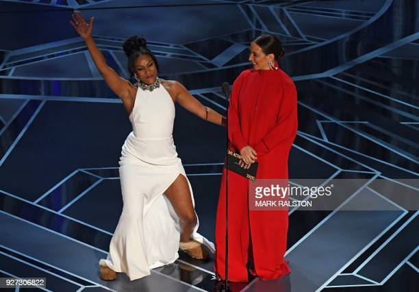 Comedian Tiffany Haddish US actress Maya Rudolph present during the 90th Annual Academy Awards show on March 4 2018 in Hollywood California / AFP...