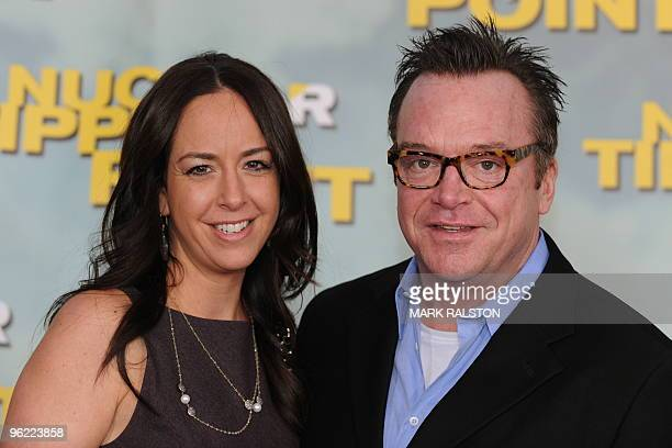 Comedian Tom Arnold and his new wife Ashley arrive on the red carpet for the premiere of the documentary film 'Nuclear Tipping Point' at the...