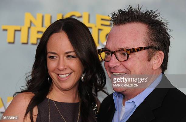 Comedian Tom Arnold and his new wife Ashley, arrive on the red carpet for the premiere of the documentary film 'Nuclear Tipping Point' at the...