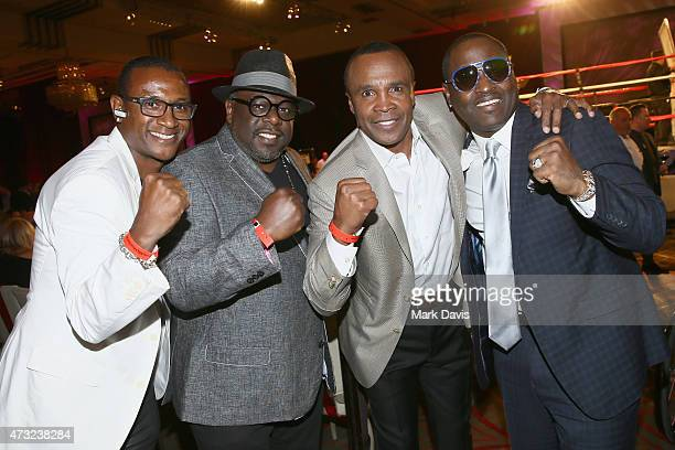 Comedian Tommy Davidson actor Cedrick the Entertainer former boxer Sugar Ray Leonard and singer Johnny Gill attend B Riley Co And Sugar Ray Leonard...