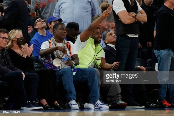 Comedian Tracy Morgan and rapper A$AP Ferg watch during the second half between the Boston Celtics and the New York Knicks at Madison Square Garden...