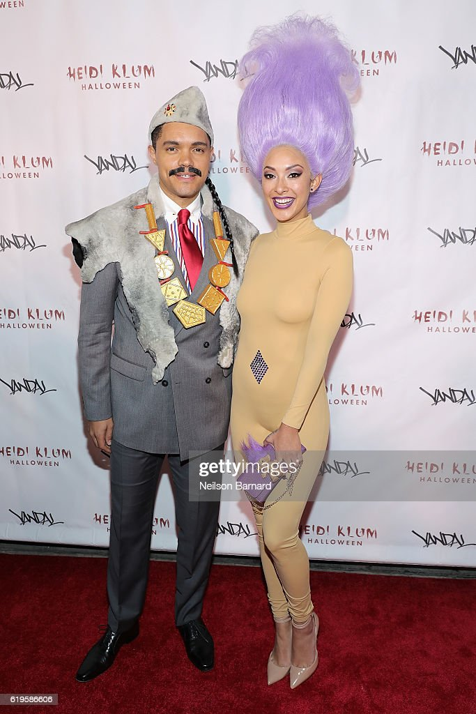 Comedian Trevor Noah and singer Jordyn Taylor attend Heidi Klum's 17th Annual Halloween Party sponsored by SVEDKA Vodka at Vandal on October 31, 2016 in New York City.