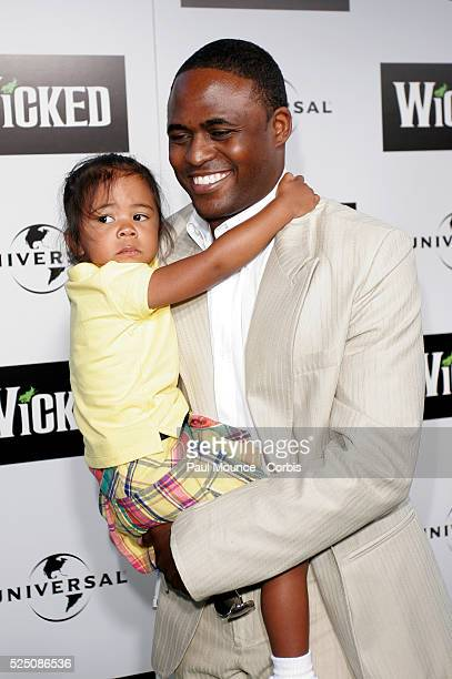 Comedian Wayne Brady and his daughter Maile arrive at the Los Angeles premiere of the Broadway musical Wicked hosted by Universal Pictures at the...