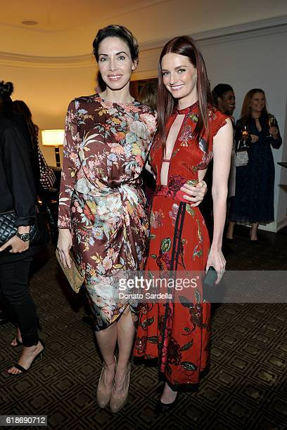 Comedian Whitney Cummings and actress Lydia Hearst in Burberry attend the Vanity Fair and Burberry event celebrating Felicity Jones and the British...