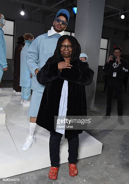 Comedian Whoopi Goldberg poses with a model at the Gypsy Sport presentation during New York Fashion Week Men'sFall/Winter 2016 at Skylight at...
