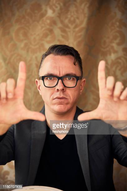 comedian with camera hand gesture - heshphoto stock pictures, royalty-free photos & images
