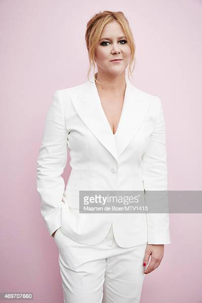 LOS ANGELES CA APRIL 12 2015 Comedian writer and producer Amy Schumer poses for a portrait at the 2015 MTV Movie Awards at Nokia Theatre LA on April...