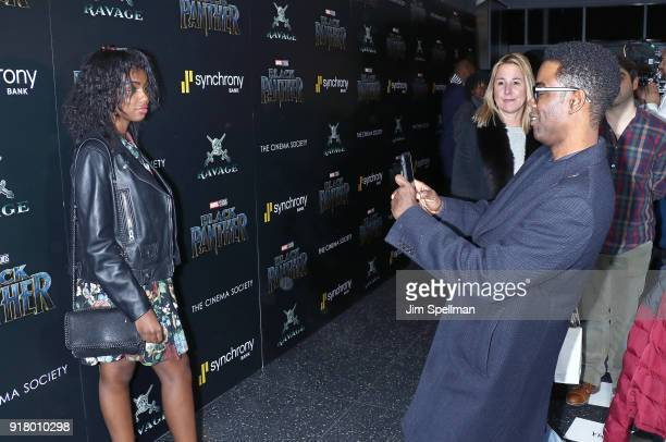 Comedian/actor Chris rock shoots a picture of daughter Zahra Rock at the screening of Marvel Studios' 'Black Panther' hosted by The Cinema Society...