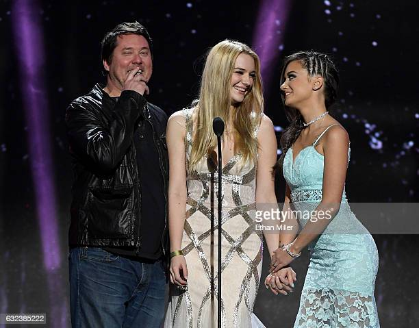 Comedian/actor Doug Benson and adult film actresses Kenna James and Gia Paige present an award during the 2017 Adult Video News Awards at The Joint...