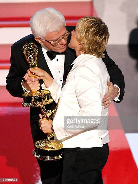 Comedian/host Ellen DeGeneres accepts the Emmy for Outstanding Talk Show from Phil Donahue onstage during the 34th Annual Daytime Emmy Awards held at...
