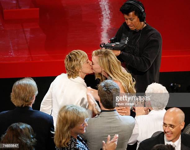 Comedian/host Ellen DeGeneres and actress Portia Di Rossi kiss in the audience after 'The Ellen DeGeneres Show' is announced as the winner of...