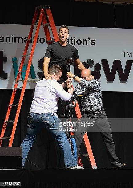Comedian/juggler Jeff Civillico is assisted by audience members Antonio Trillo and Kevin Wogalter during his performance at The Animal Foundation's...