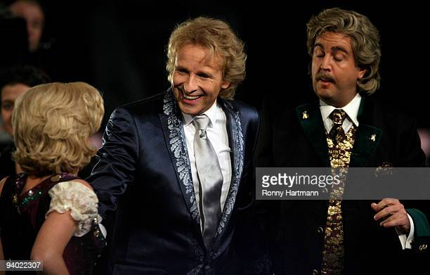 Comedians Anke Engelke and Bastian Pastewka perform as Wolfgang and Anneliese next to host Thomas Gottschalk attends the Wetten dass show at the AWD...