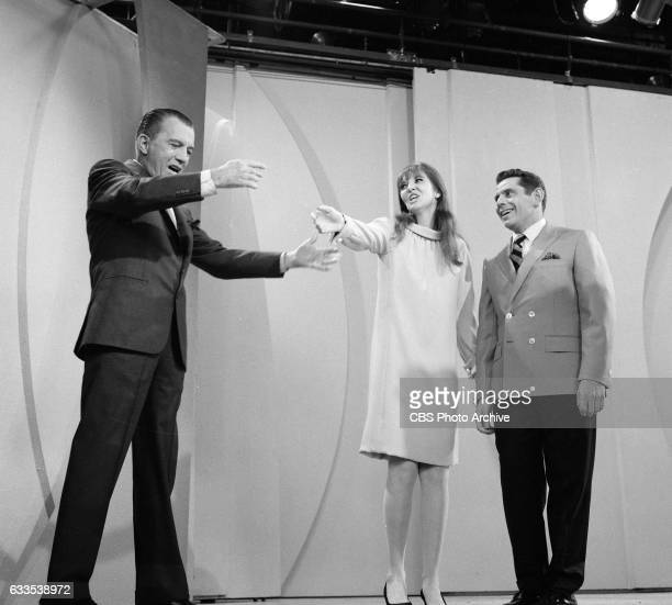 Comedians Anne Meara and Jerry Stiller appear on The Ed Sullivan Show on Sunday May 14 1967 Host Ed Sullivan stands at left
