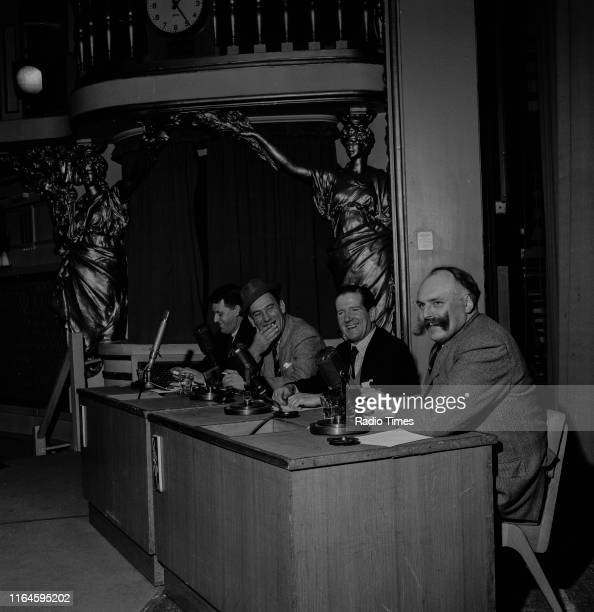 Comedians Bernard Braden, Tommy Trinder, Ted Ray and Jimmy Edwards sitting behind the microphones during a recording for the BBC Radio 4 comedy...