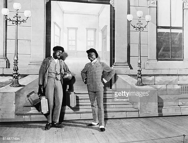 """Comedians Bert Williams and George Walker on stage in """"Sons of Ham."""" Photograph, c. 1900."""