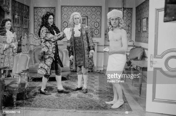 Comedians Bob Raymond Michael Palin Eric Idle and Terry Jones in the 'Louis XVI' sketch from series 4 the BBC television show 'Monty Python's Flying...