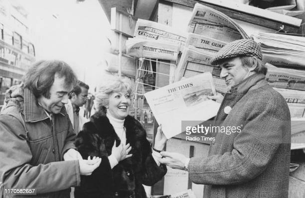 Comedians Chris Emmett Janet Brown and Roy Hudd at a news stand for the BBC Radio 2 sketch show 'The News Huddlines' 1975