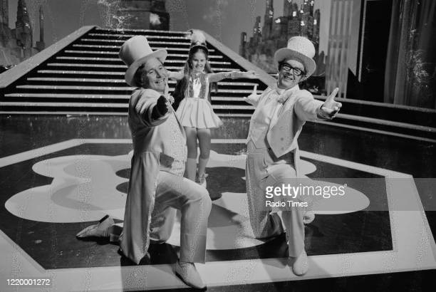 Comedians Eric Morecambe and Ernie Wise dancing in a sketch for the BBC television show 'The Morecambe and Wise Show', April 8th 1976.