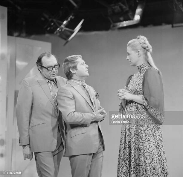 Comedians Eric Morecambe and Ernie Wise filming a sketch from the BBC television series 'The Morecambe and Wise Christmas Show' 1970