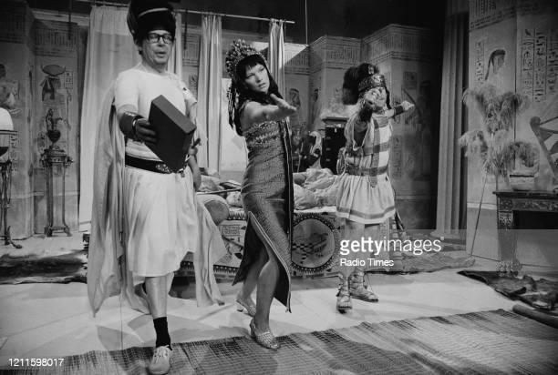 Comedians Eric Morecambe and Ernie Wise in a sketch with actress Glenda Jackson for the BBC television series 'The Morecambe and Wise Show', May 11th...