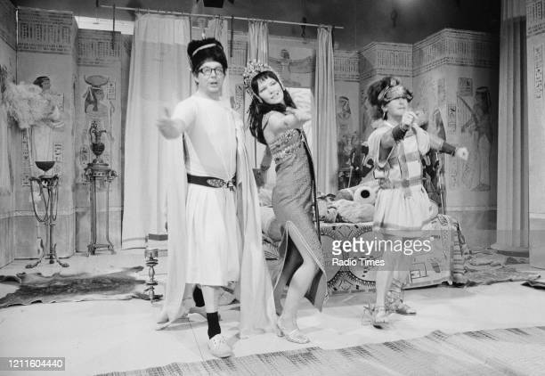 Comedians Eric Morecambe and Ernie Wise in a sketch with actress Glenda Jackson for the BBC television series 'The Morecambe and Wise Show' May 11th...