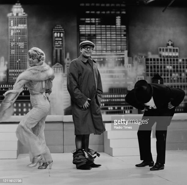Comedians Eric Morecambe and Ernie Wise performing with actress Jenny Lee Wright during filming for the BBC television series 'The Morecambe and Wise...