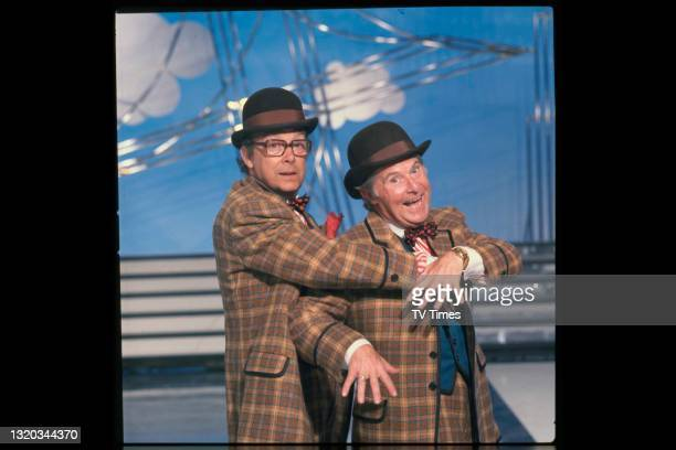 Comedians Eric Morecambe and Ernie Wise photographed during a rehearsal for their series The Morecambe & Wise Show, circa 1981.
