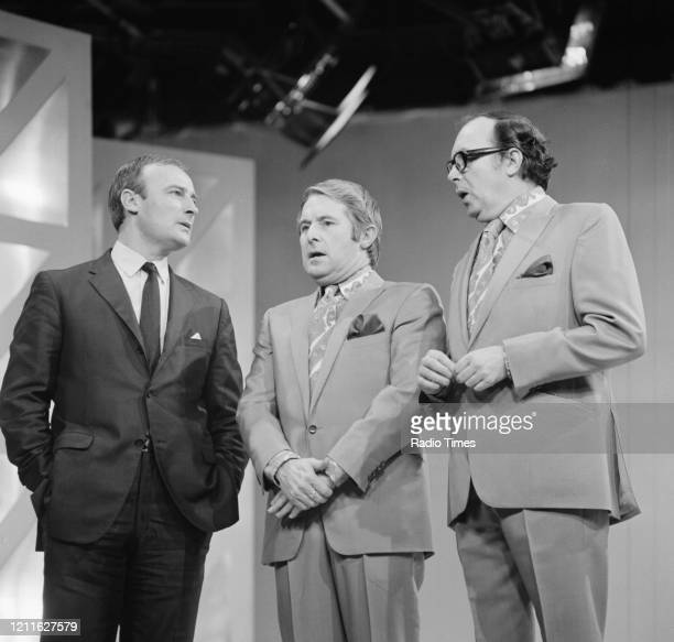 Comedians Eric Morecambe and Ernie Wise , with actor Edward Woodward, filming a sketch for the BBC television series 'The Morecambe and Wise...