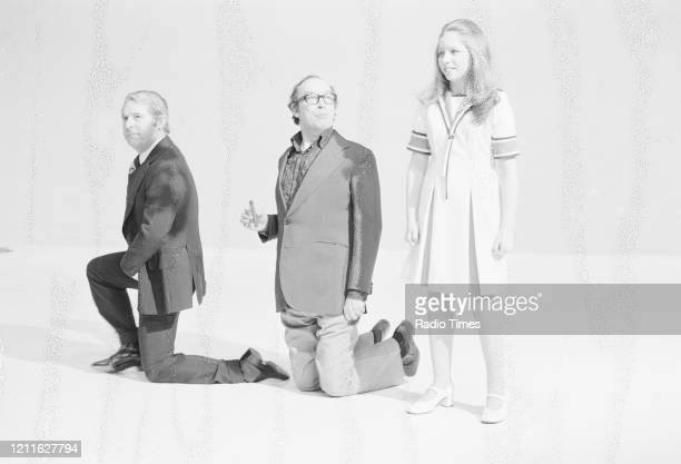 Comedians Eric Morecambe and Ernie Wise, with singer Lena Zavaroni, in a sketch from the BBC television series 'The Morecambe and Wise Show',...