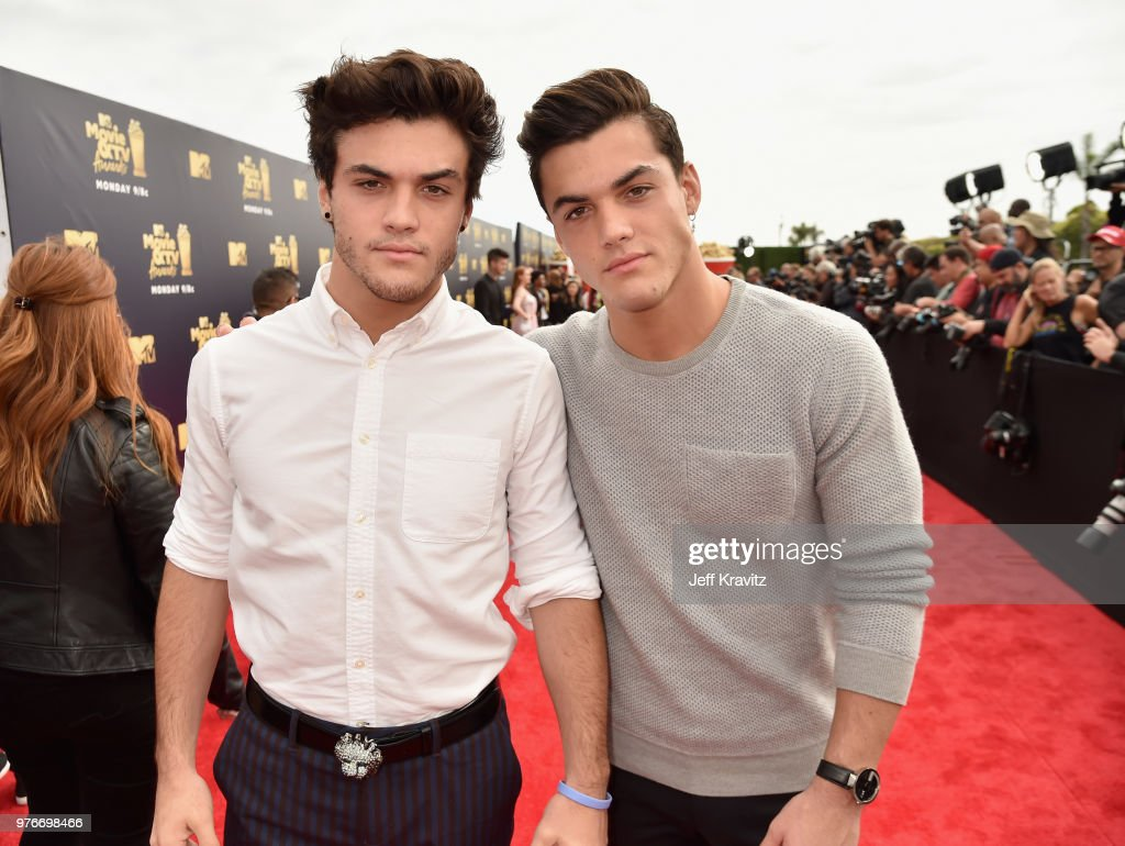 Comedians Ethan Dolan (L) and Grayson Dolan attend the 2018 MTV Movie And TV Awards at Barker Hangar on June 16, 2018 in Santa Monica, California.