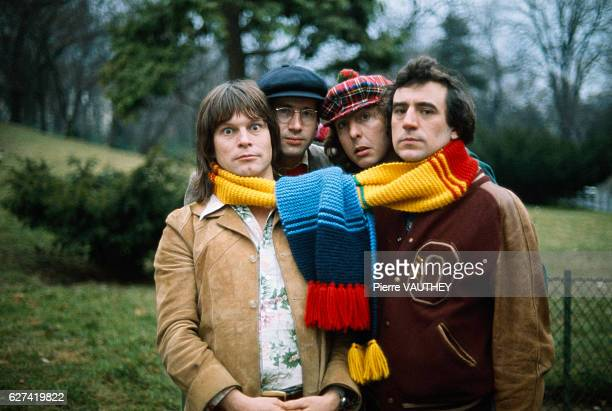 Comedians from the British comedy troupe Monty Python pose with a large scarf around their necks during a visit to Paris Terry Gilliam musician and...