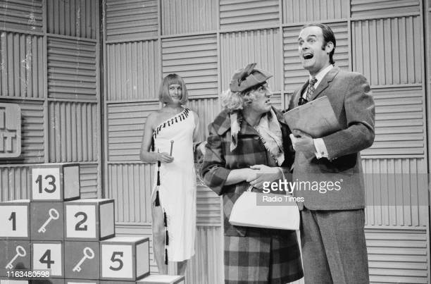 Comedians Graham Chapman Terry Jones and John Cleese in the 'Take Your Pick' sketch from series 2 of the BBC television show 'Monty Python's Flying...