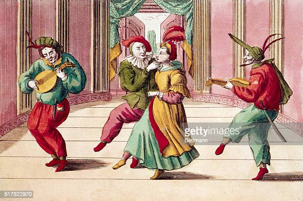 Comedians in a commedia dell'arte troupe act their parts on a stage Commedia dell'arte a theatrical form of the 16th18th centuries featured masked...