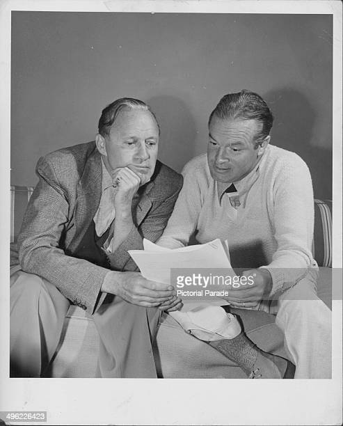 Comedians Jack Benny and Bob Hope reading a script together for the Palm Springs broadcast of 'The Jack Benny Program' California April 1950