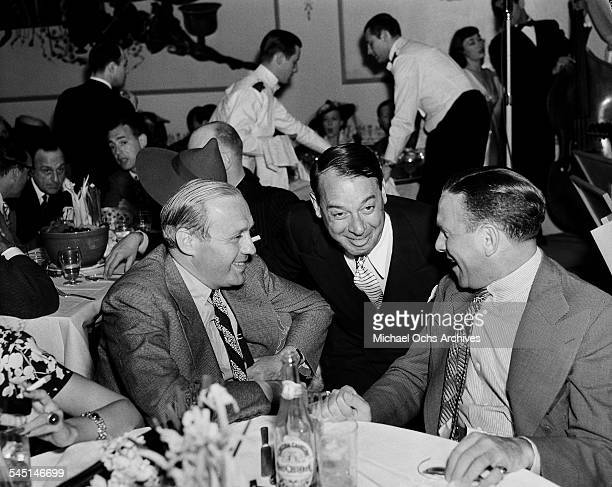 Comedians Jack Benny and George Burns attend an event in Los Angeles California