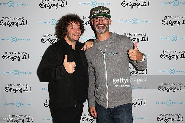 Comedians Jeff Ross and Brody Stevens arrive at the Brody Stevens Enjoy It Premiere Party at Smogshoppe on November 21 2013 in Los Angeles California