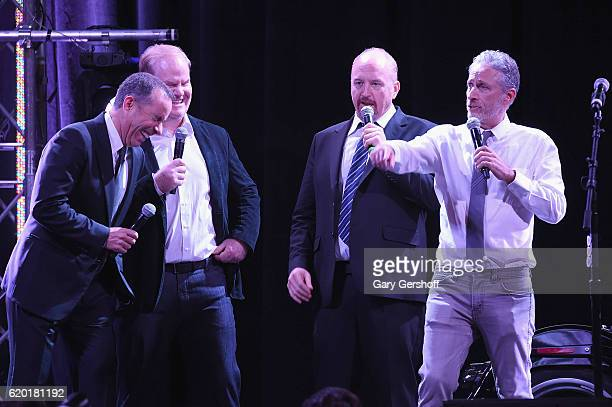 Comedians Jerry Seinfeld, Jim Gaffigan, Jon Stewart and Louis C.K. Perform on stage during the 10th Annual Stand Up For Heroes show at The Theater at...