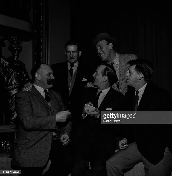 Comedians Jimmy Edwards Ted Ray Tommy Trinder Bernard Braden and McDonald Hobley during a recording for the BBC Radio 4 comedy series 'Does the Team...