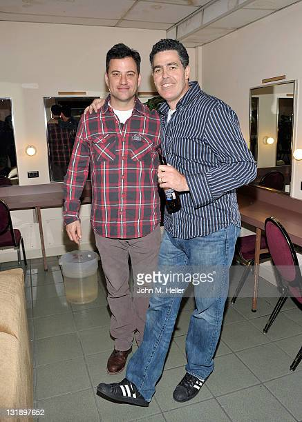 Comedians Jimmy Kimmel helps Adam Carolla celebrate the release of his new paperback book 'In Fifty Years We'll All Be Chicks' on May 21 2011 in Los...