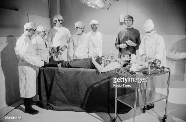 Comedians John Cleese, Terry Gilliam, Eric Idle, Graham Chapman, Carol Cleveland and Michael Palin in the 'Gumby Brain Surgery' sketch from series 3...