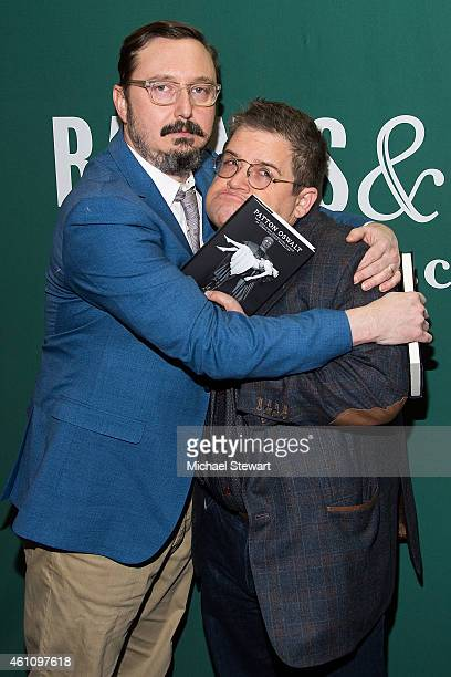 Comedians John Hodgman and Patton Oswald attend a signing for his book 'Silver Screen Fiend Learning About Life From an Addiction to Film' at Barnes...