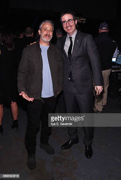Comedians Jon Stewart and John Oliver pose backstage at the New York Comedy Festival and the Bob Woodruff Foundation's 9th Annual Stand Up For Heroes...