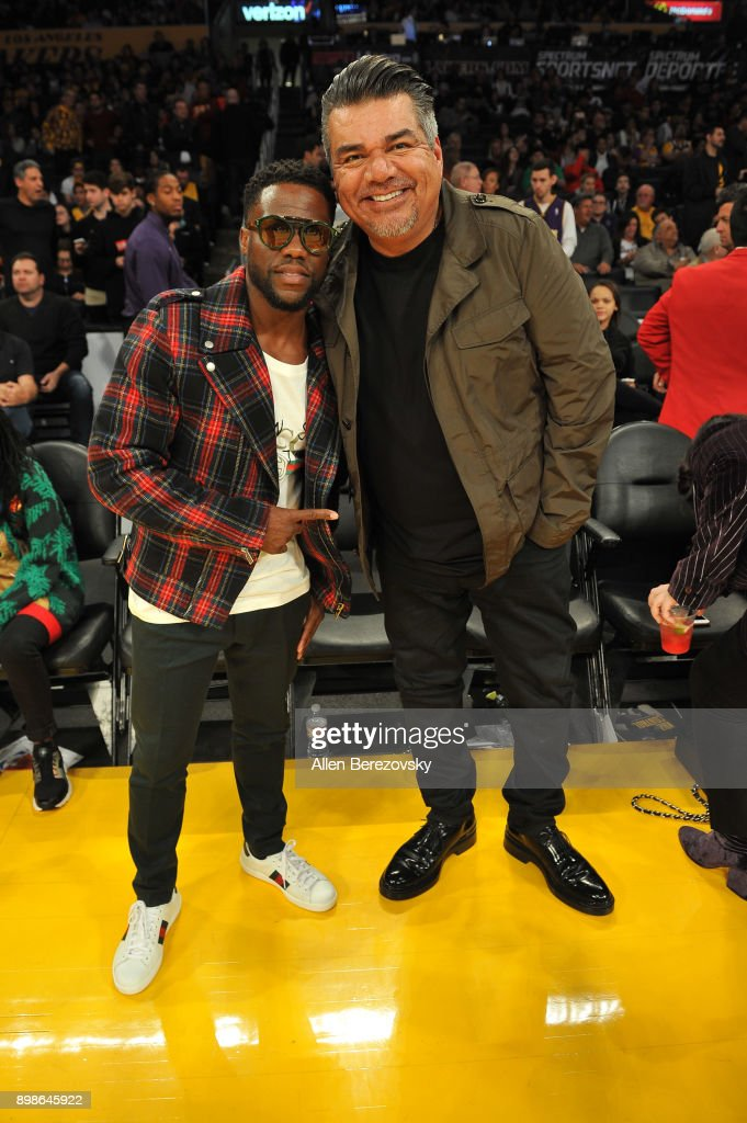 Comedians Kevin Hart (L) and George Lopez attend a basketball game between the Los Angeles Lakers and the Minnesota Timberwolves at Staples Center on December 25, 2017 in Los Angeles, California.