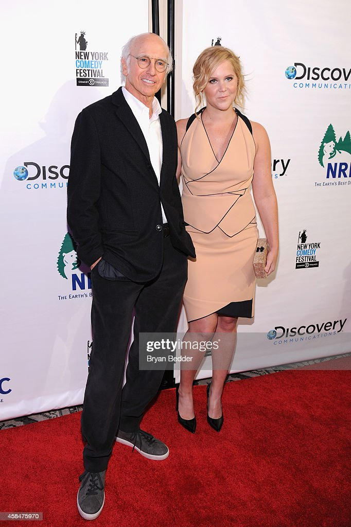 Comedians Larry David (L) and Amy Schumer attend NRDC's 'Night Of Comedy' benefiting the Natural Resources Defense Council at 583 Park Ave on November 5, 2014 in New York City.
