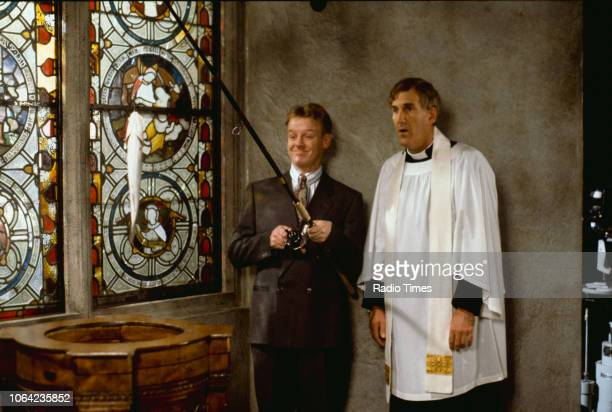 Comedians Les Dennis and Russ Abbot in a church sketch from the BBC Television series 'The Russ Abbot Show' May 17th 1991