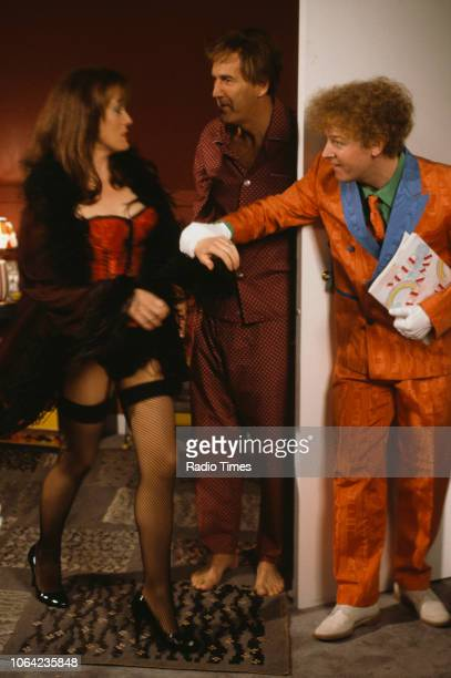 Comedians Les Dennis and Russ Abbot with an unknown actress in a sketch from the BBC Television series 'The Russ Abbot Show' May 17th 1991